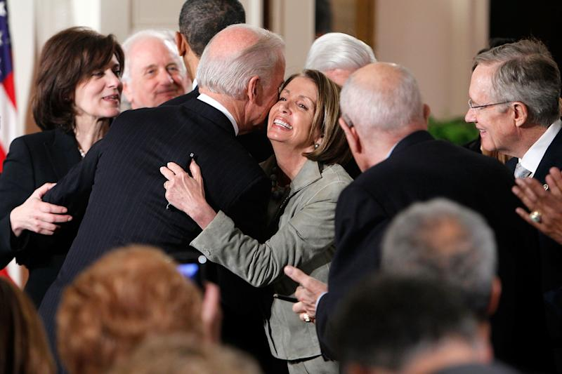 Vice President Joseph Biden hugs Speaker of the House Rep. Nancy Pelosi, D-Calif., during an event celebrating the Affordable Care Act in the East Room of the White House. March 23, 2010. (Photo by Alex Wong/Getty Images)