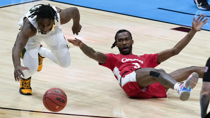 Baylor guard Davion Mitchell, left, runs down a loose ball ahead of Houston guard DeJon Jarreau (3) during the second half of a men's Final Four NCAA college basketball tournament semifinal game, Saturday, April 3, 2021, at Lucas Oil Stadium in Indianapolis. (AP Photo/Darron Cummings)