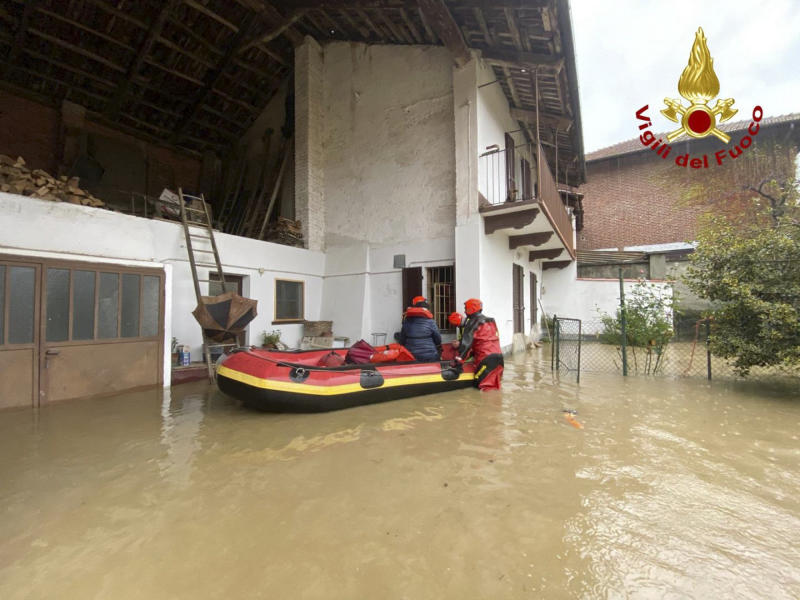 Firefighters evacuate people from house in Carde, near Cuneo, in the Piedmont region of northern Italy