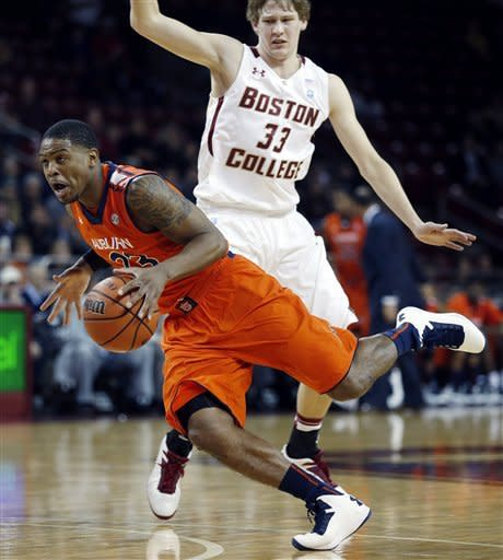 Auburn's Frankie Sullivan (23) drives past Boston College's Patrick Heckmann (33) during the first half of an NCAA college basketball game in Boston, Wednesday, Nov. 21, 2012. (AP Photo/Michael Dwyer)