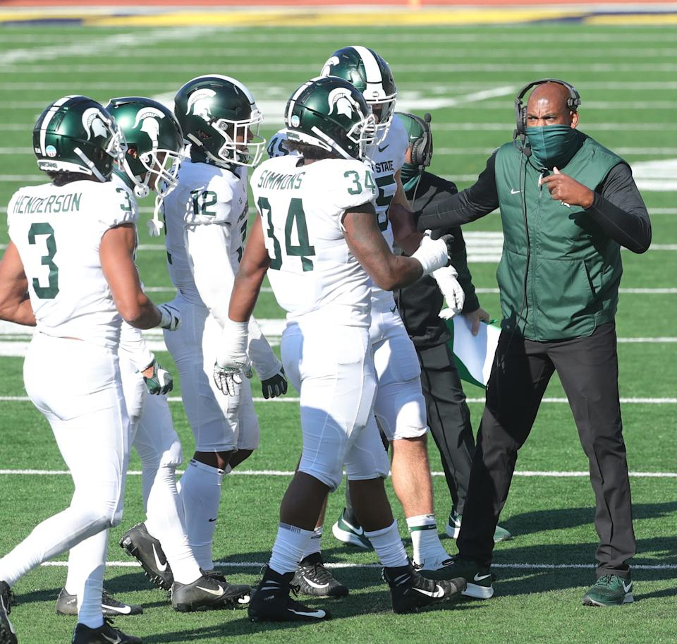 Michigan State Spartans coach Mel Tucker talks with his players during the third quarter against Michigan at Michigan Stadium in Ann Arbor, Saturday, Oct. 31, 2020.