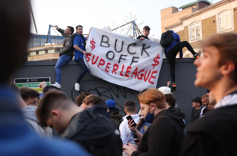 Chelsea fans hold a banner outside the stadium before the match after reports suggest they are set to pull out of the European Super League.