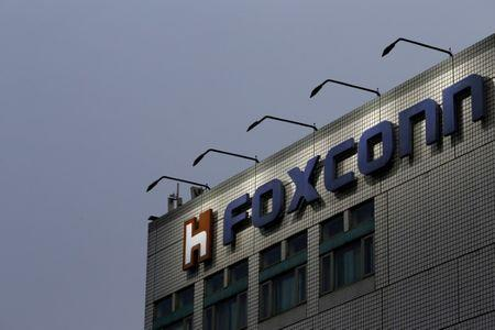 FILE PHOTO - The logo of Foxconn, the trading name of Hon Hai Precision Industry, is seen on top of the company's headquarters in New Taipei City, Taiwan on March 29, 2016. REUTERS/Tyrone Siu/File Photo