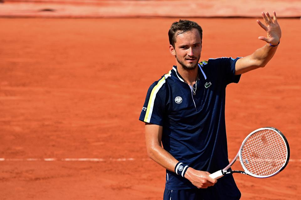 Russia's Daniil Medvedev celebrates after winning against Chile's Christian Garin.