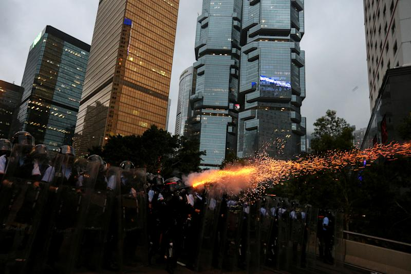 Police officers fire tear gas during a demonstration against a proposed extradition bill in Hong Kong, China June 12, 2019. REUTERS/Athit Perawongmetha