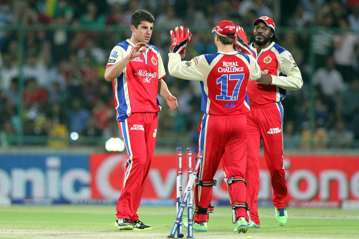Royal Challengers Bangalore players Moises Henriques ,AB de Villiers , Chris Gayle celebrates the wicket of Delhi Daredevils player David Warner  during match 57 of of the Pepsi Indian Premier League between Delhi Daredevils and the Royal Challengers Bangalore held at the Feroz Shah Kotla Stadium, Delhi on the 10th May 2013. (BCCI)