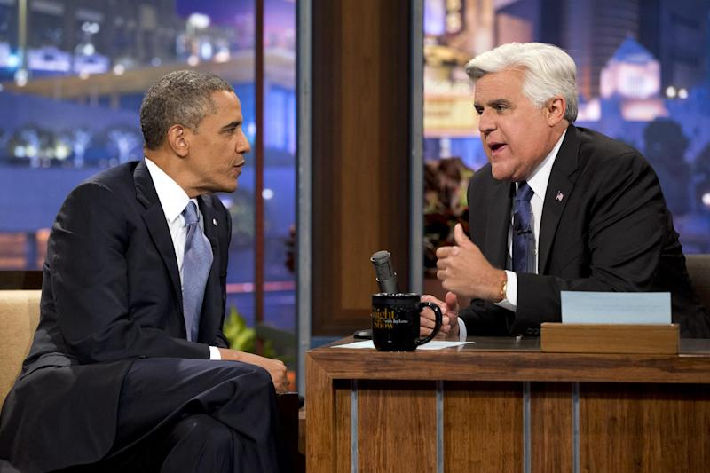 "President Barack Obama, left, talks with Jay Leno during a commercial break during the taping of his appearance on ""The Tonight Show with Jay Leno"" in Los Angeles, Tuesday, Aug. 6, 2013. (AP Photo/Jacquelyn Martin)"