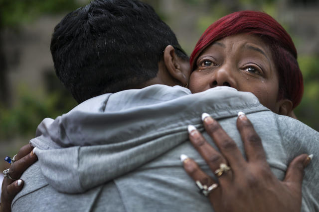 WASHINGTON, DC - MAY 9: Maria Hamilton, founder of Mothers For Justice United, cries as she gets a hug from Pastor Traci Blackmon at the Million Mom March in Washington, DC on May 9, 2015. Her son Donte, who had been with paranoid schizophrenia, was shot and killed by a Milwaukee police officer in 2014. Maria along with hundreds of supporters and other mothers turned out for the Million Mom March to protest child gun deaths, including those at the hands of police. The women marched to the offices of the Department of Justice and presented their demands for justice and racial equality, in the names of their slain children. Among those demands, asking that the federal government keep a registry of officer-involved shootings and investigate each one, the halt of supplying police forces with military equipment, and that body cameras not have the ability to be turned off and on by officers. (Photo by Linda Davidson / The Washington Post via Getty Images)