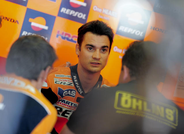 Repsol Honda Team's Spanish Dani Pedrosa speaks with his engineers in his pits at the Catalunya racetrack in Montmelo, near Barcelona, on June 2, 2012, during the MotoGP third training session of the Catalunya Moto GP Grand Prix. AFP PHOTO / JOSEP LAGOJOSEP LAGO/AFP/GettyImages
