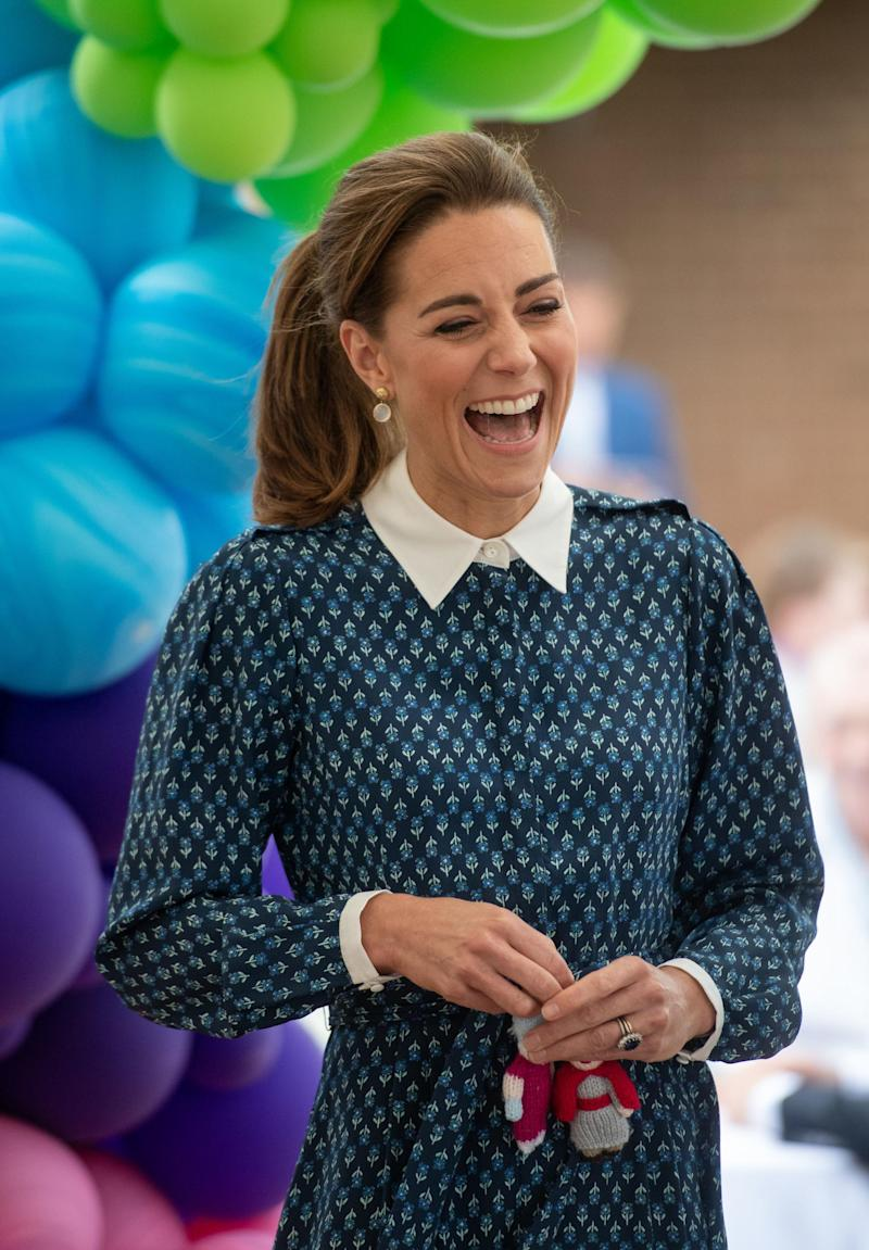 The Duchess rocking her power pony at afternoon tea earlier this week (Getty Images )