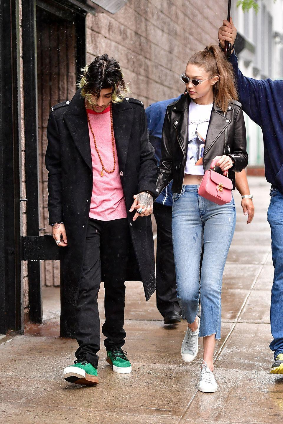 <p>In a Fiorucci graphic tee under a black moto jacket with light-wash cropped jeans, grey sneakers, a pink clutch, and clear-framed sunglasses while out in New York City with her boyfriend Zayn.</p>
