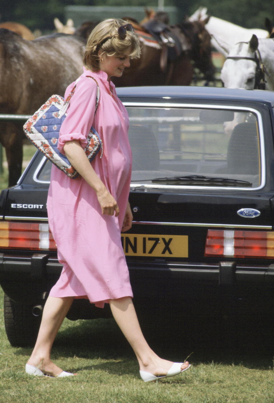 <p>Princess Diana wears a pink caftan-style dress for polo at Windsor while pregnant with Prince William. (Photo: Getty Images) </p>