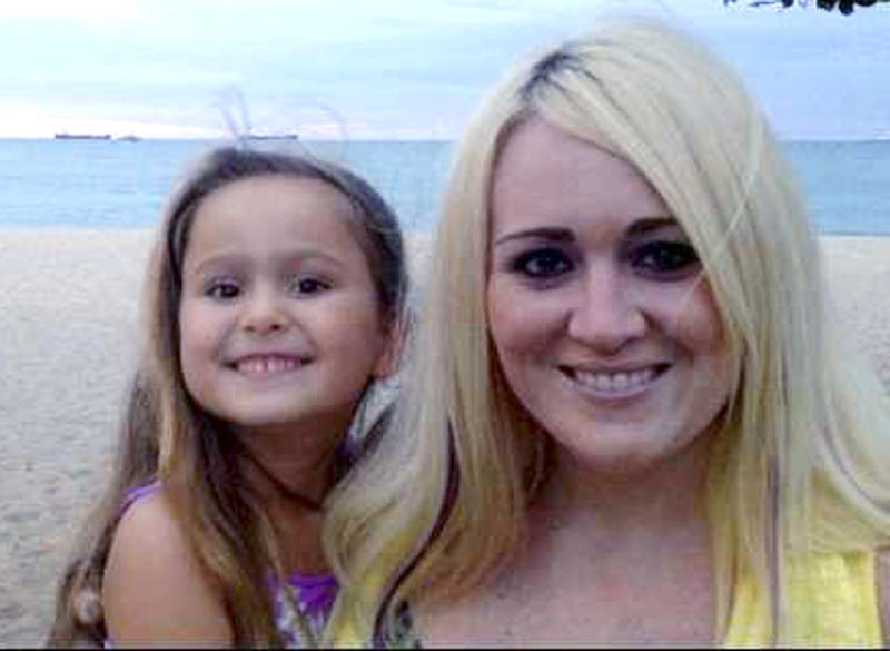 This 2013 family photo provided by Lindsey DeFilipi shows Ava Machado, left, with her mother Shauna Hadden, of Agawam, Mass. Hadden, a Massachusetts mom says she and her 6-year-old daughter are stranded in Brazil after police seized their passports because of a custody battle with the child's father. (AP Photo/Family Photo)