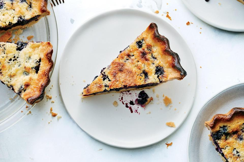 """Parbaking the crust of this blueberry pancake–flavored custard pie ensures the bottom will be crisp when it's done. <a href=""""https://www.epicurious.com/recipes/food/views/blueberry-buttermilk-chess-pie?mbid=synd_yahoo_rss"""" rel=""""nofollow noopener"""" target=""""_blank"""" data-ylk=""""slk:See recipe."""" class=""""link rapid-noclick-resp"""">See recipe.</a>"""