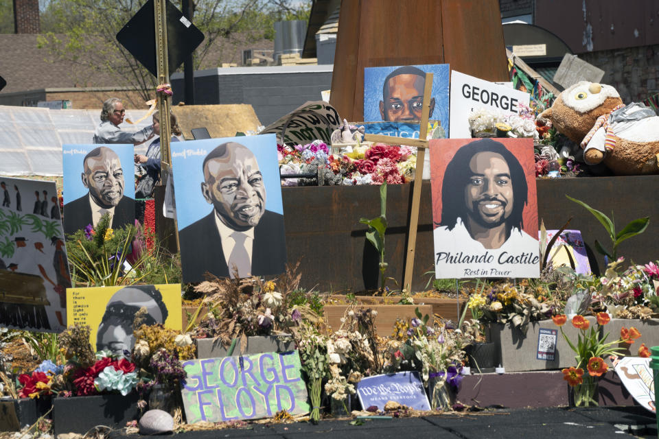 Flowers line the street at George Floyd Square in Minneapolis. Photos of other Black people killed by police officers also fill the area, located at the intersection of 38th St. and Chicago Ave. (Judy Griesedieck for Yahoo News)
