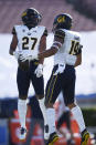 California linebacker Cameron Goode celebrates with safety Trey Paster after recovering a blocked punt during the first half of an NCAA college football game against UCLA in Los Angeles, Sunday, Nov. 15, 2020. (AP Photo/Kelvin Kuo)
