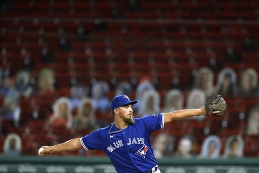 Toronto Blue Jays' A.J. Cole pitches in front of cutouts in the empty stands during the seventh inning of a baseball game against the Boston Red Sox, Friday, Aug. 7, 2020, in Boston. (AP Photo/Michael Dwyer)