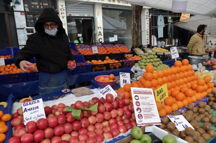 Geyik waits for customers at his stall at a local market in Fatih district in Istanbul