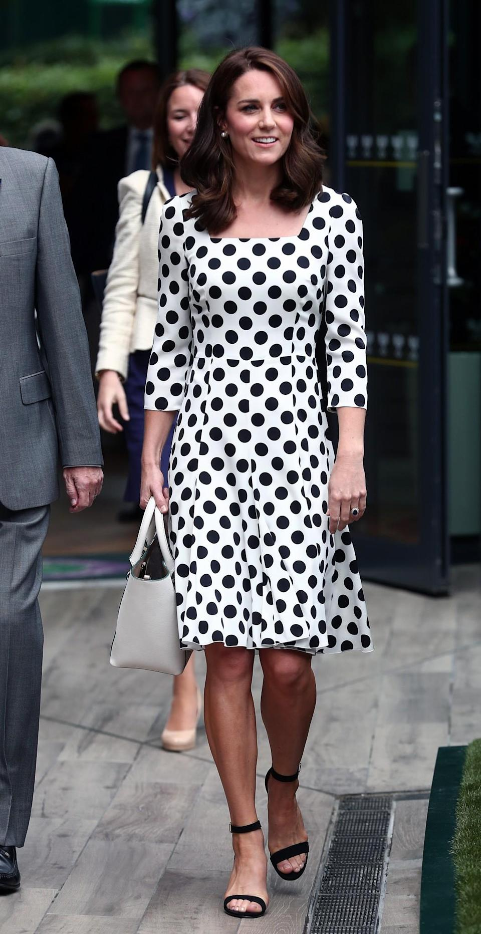<p>The Duchess arrived for the first day of Wimbledon in a stand-out polka dot dress by Dolce & Gabbana. Sporting a brand new shorter hairstyle, Kate paired the £930 dress with block-heeled sandals and a white leather bag.<br><i>[Photo: PA]</i> </p>