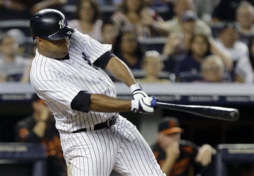 New York Yankees' Vernon Wells follows through on an RBIsingle during the ninth inning to win a baseball game against the Baltimore Orioles, Friday, July 5, 2013, in New York. The Yankees won the game 3-2. (AP Photo/Frank Franklin II)
