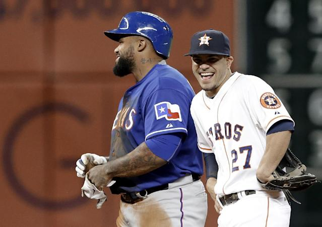 Texas Rangers' Prince Fielder, left, and Houston Astros second baseman Jose Altuve (27) laugh during a review of a play in the fourth inning of a baseball game Tuesday, May 13, 2014, in Houston. Fielder had tried to stretch a single, and after a review of the close play was called out at second. (AP Photo)