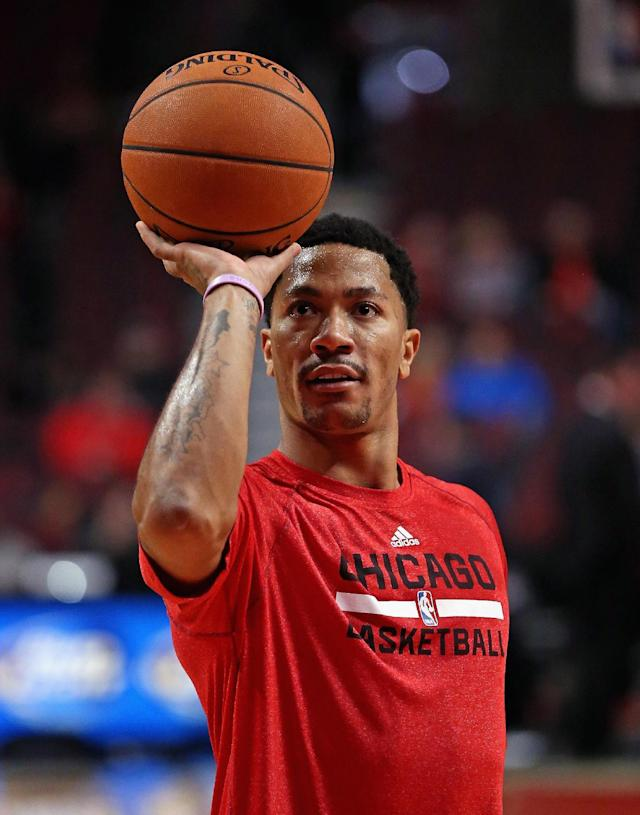 CHICAGO, IL - FEBRUARY 11: Derrick Rose #1 of the Chicago Bulls, who suffered a season-ending knee injury in November, practices his shooting before the Bulls take on the Atlanta Hawks at the United Center on February 11, 2014 in Chicago, Illinois. (Photo by Jonathan Daniel/Getty Images)