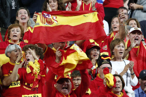 Spanish tennis fans react as France's Lucas Pouille plays Spain's Roberto Bautista Agut during the Davis Cup semifinals France against Spain, Friday, Sept.14, 2018 in Lille, northern France. (AP Photo/Michel Spingler)