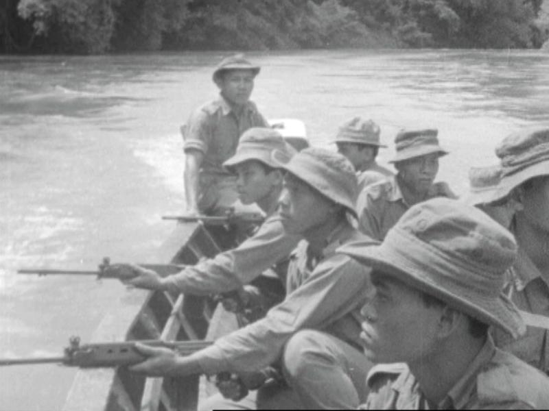 First Sarawak Rangers with machine-guns patrol Sarawak in a longboat amid ongoing clashes with Indonesian forces. — Screengrab from Reuters archive footage
