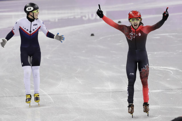 <p>Samuel Girard of Canada celebrates as he crosses the finish line ahead of John-Henry Krueger of the United States in the men's 1000 meters short track speedskating final in the Gangneung Ice Arena at the 2018 Winter Olympics in Gangneung, South Korea, Saturday, Feb. 17, 2018. (AP Photo/David J. Phillip) </p>