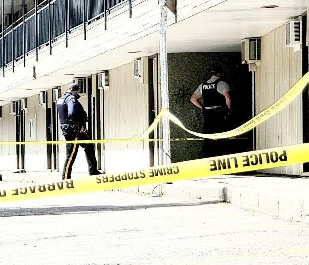 Numerous RCMP officers were on scene behind a downtown Prince George, B.C., motel Monday morning, after a man was shot during a police incident. (Betsy Trumpener/CBC - image credit)