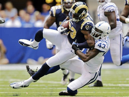 St. Louis Rams wide receiver Brian Quick (83) is tackled by Indianapolis Colts defensive back DJ Johnson (43) after making a first down in the first half of an NFL preseason football game in Indianapolis, Sunday, Aug. 12, 2012. (AP Photo/Michael Conroy)