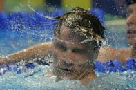 Bobby Finke reacts after winning the men's 1500 freestyle during wave 2 of the U.S. Olympic Swim Trials on Sunday, June 20, 2021, in Omaha, Neb. (AP Photo/Charlie Neibergall)