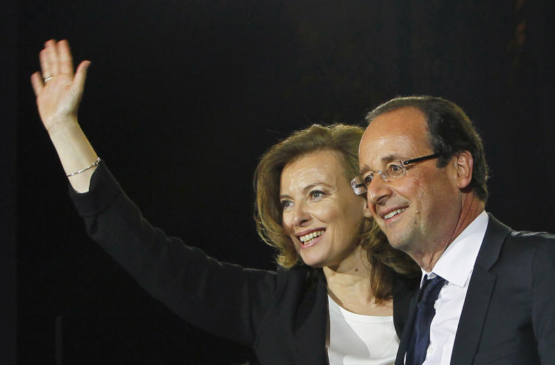 "FILE   This Sunday, May 6, 2012 file photo shows French president-elect Francois Hollande waving to supporters with his companion Valerie Trierweiler as he celebrates his election victory in Bastille Square in Paris, France.   More than three weeks after her partner Francois Hollande took office as France's president, Valerie Trierweiler still doesn't know what she wants to be called.In an interview Thursday June 7, 2012 on France-Inter radio, Trierweiler said she feels the term ""first lady"" is a bit old-school, and she's been fielding ideas about the right way to refer to her.  (AP Photo/Francois Mori)"