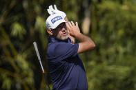 Lee Westwood, of England, reacts to his tee shot on the 11th hole during the final round of The Players Championship golf tournament Sunday, March 14, 2021, in Ponte Vedra Beach, Fla. (AP Photo/Gerald Herbert)