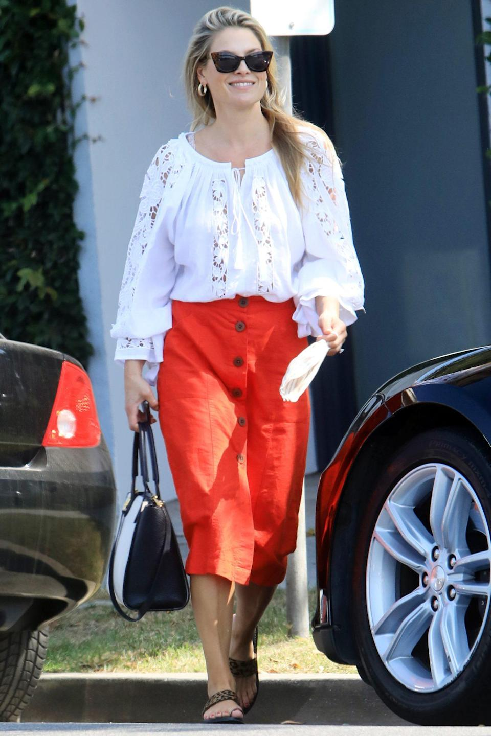 <p>Ali Larter looks ready for fall weather in a white Florii peasant blouse and red midi-skirt while running errands on Wednesday in L.A. </p>