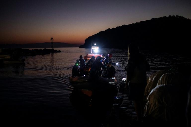 Migrants are seen on board a boat following a rescue operation by a Frontex patrol vessel at the port of Skala Sikamias, on the island of Lesbos, Greece (AFP Photo/ANGELOS TZORTZINIS)