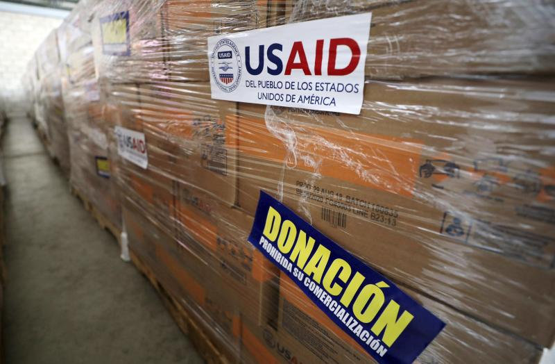 USAID humanitarian aid is stored at a warehouse next to the Tienditas International Bridge on the outskirts of Cucuta, Colombia, on the border with Venezuela, Tuesday, Feb. 19, 2019. The U.S. military airlifted tons of humanitarian aid as part of an effort meant to undermine socialist President Nicolas Maduro and back his rival for the leadership of the South American nation. (AP Photo/Fernando Vergara)
