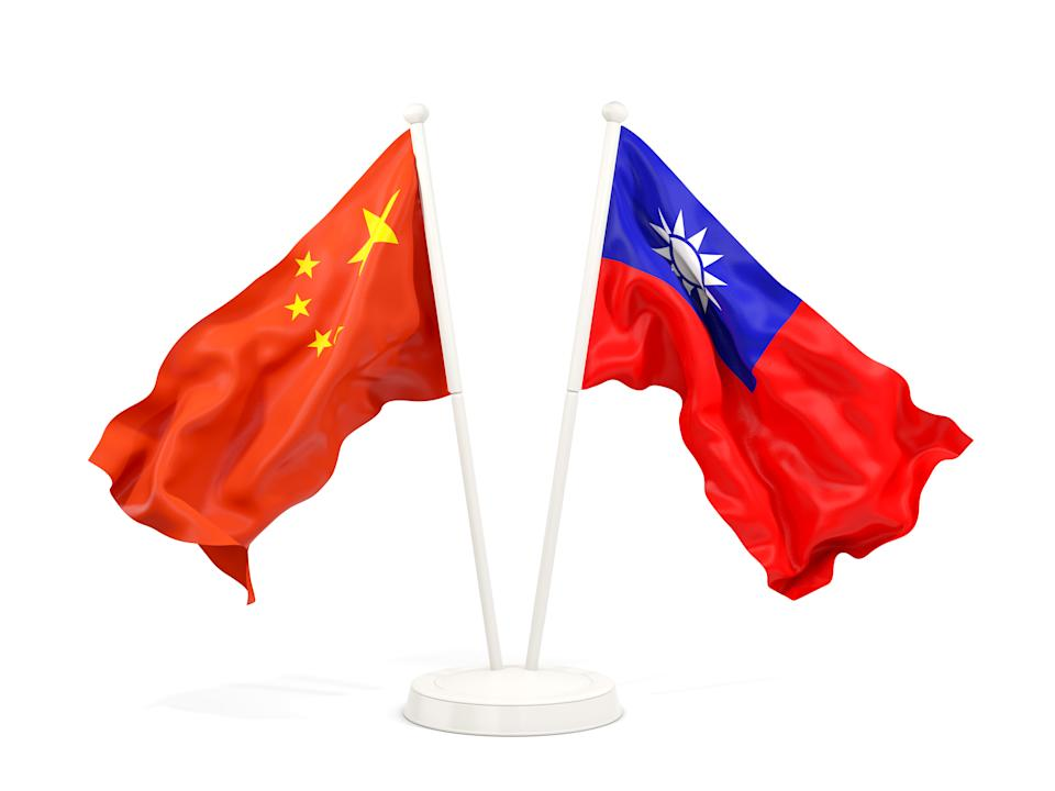 Two waving flags of China and Taiwan isolated on white. 3D illustration