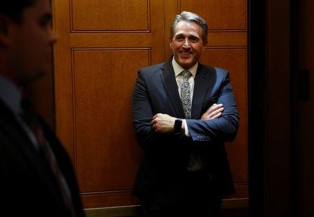 Senator Jeff Flake (R-AZ) stands in an elevator after a vote to end a government shutdown, on Capitol Hill in Washington
