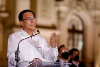 FILE PHOTO: Peru's President Martin Vizcarra addresses the media outside the presidential palace after lawmakers removed him on corruption charges, in Lima