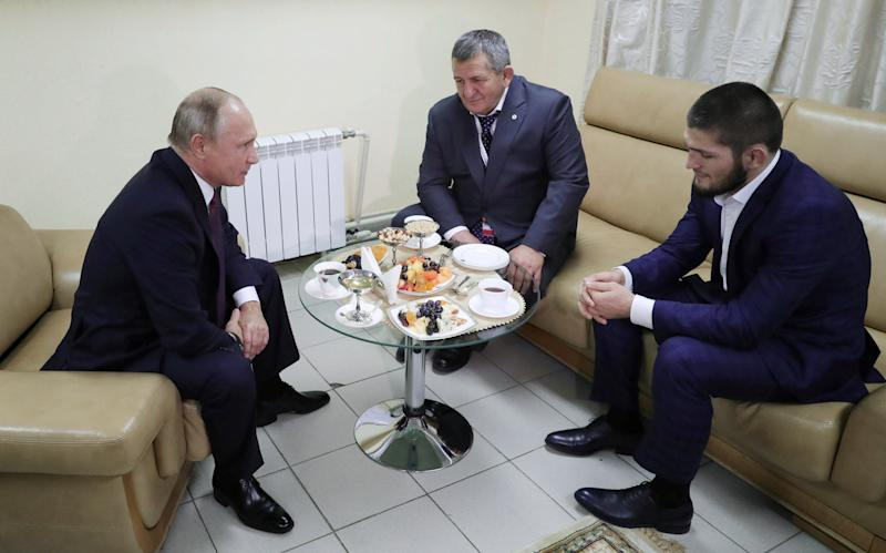 Russian President Putin meets with mixed martial arts fighter Nurmagomedov in Ulyanovsk