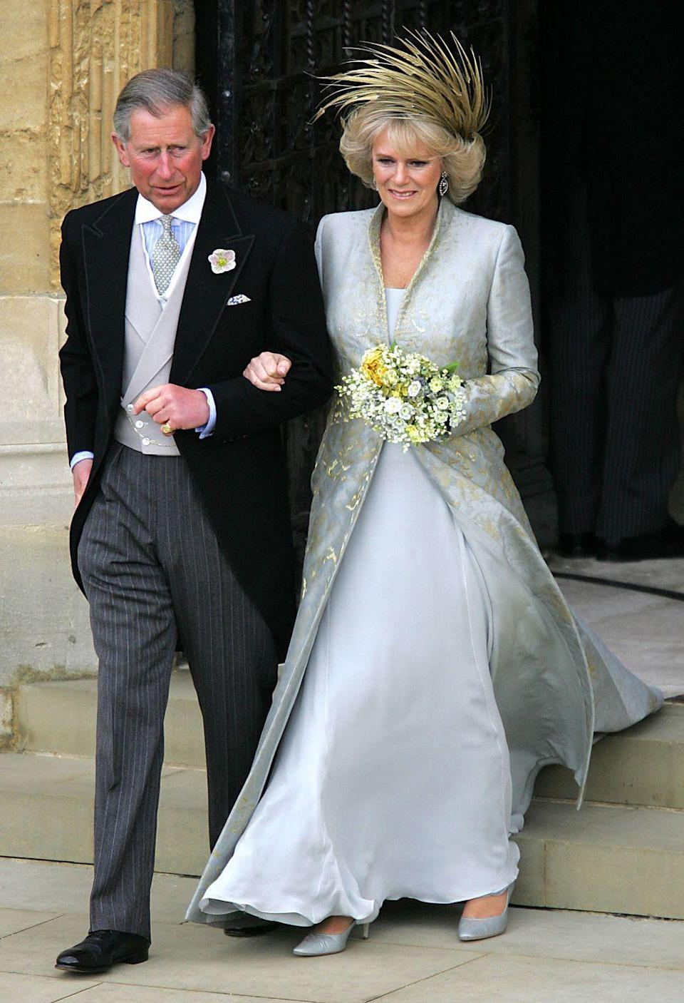 "<p><a href=""https://www.townandcountrymag.com/style/fashion-trends/g14510433/camilla-parker-bowles-fashion-style/"" rel=""nofollow noopener"" target=""_blank"" data-ylk=""slk:Camilla, Duchess Of Cornwall"" class=""link rapid-noclick-resp"">Camilla, Duchess Of Cornwall</a> married Prince Charles of Wales on April 9, 2005 at <span class=""redactor-unlink"">St. George's Chapel</span> at Windsor Guildhall. Camilla wore a soft blue chiffon dress with a sleek blue and gold damask coat. The collar of the coat was embellished with gold embroidery.</p>"