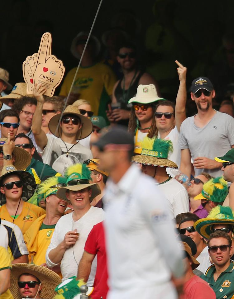BRISBANE, AUSTRALIA - NOVEMBER 22:  Members of the crowd gesture towards Kevin Pietersen of England during day two of the First Ashes Test match between Australia and England at The Gabba on November 22, 2013 in Brisbane, Australia.  (Photo by Scott Barbour/Getty Images)