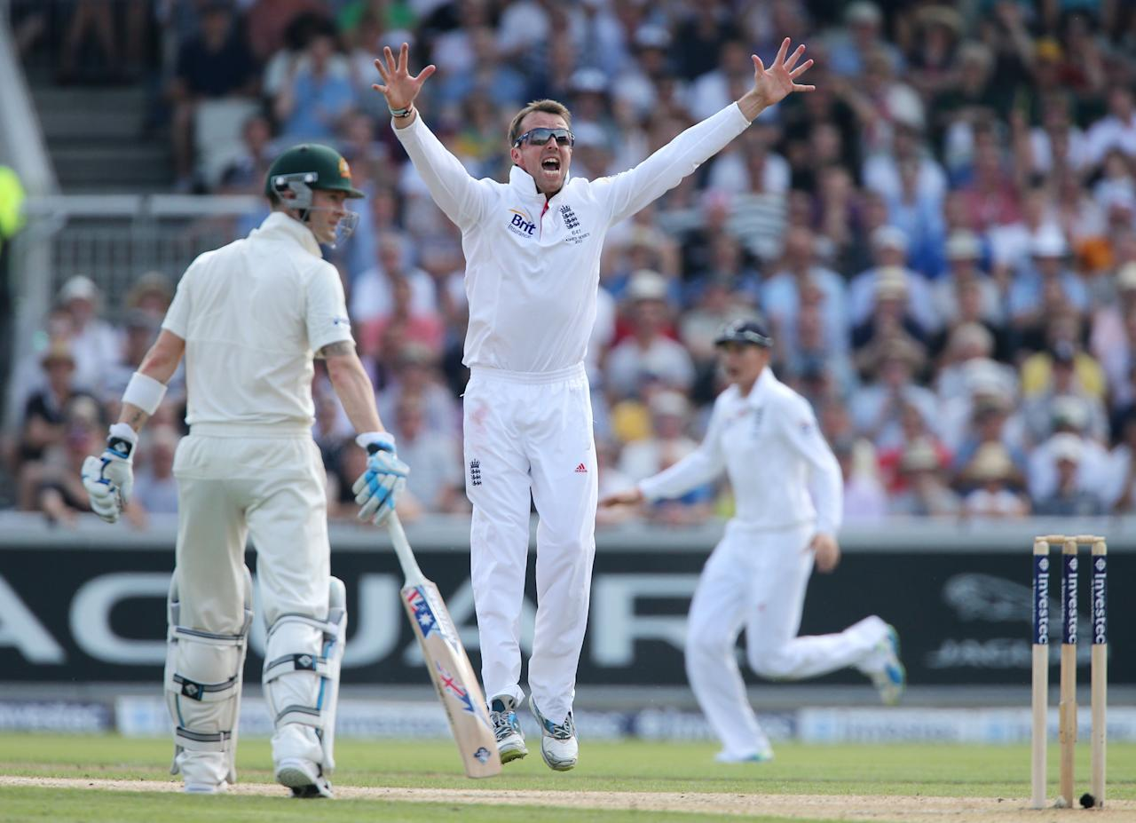 England's Graeme Swann appeals after trapping Australia batsman Chris Rogers out LBW for 84 during day one of the Third Investec Ashes test match at Old Trafford Cricket Ground, Manchester.