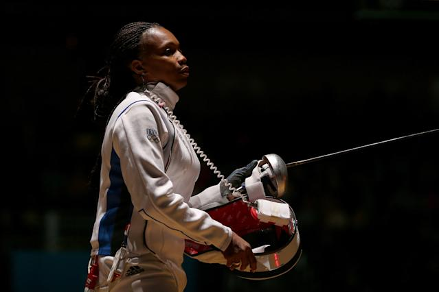 LONDON, ENGLAND - JULY 30: Laura Flessel-Colovic of France looks on against Courtney Hurley of the United States during the Women's Epee Individual Fencing round 32 of on Day 3 of the London 2012 Olympic Games at ExCeL on July 30, 2012 in London, England. (Photo by Hannah Johnston/Getty Images)