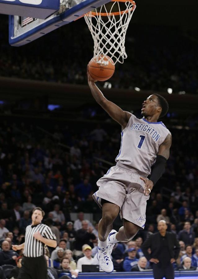 Creighton's Austin Chatman (1) scores during the first half of an NCAA college basketball game against DePaul in the quarterfinals of the Big East Conference tournament Thursday, March 13, 2014, at Madison Square Garden in New York. (AP Photo/Frank Franklin II)