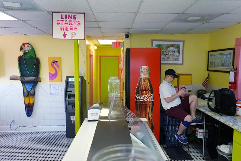 Stew Polsoni waits for customers at an ice cream shop in Key West on 25 March.