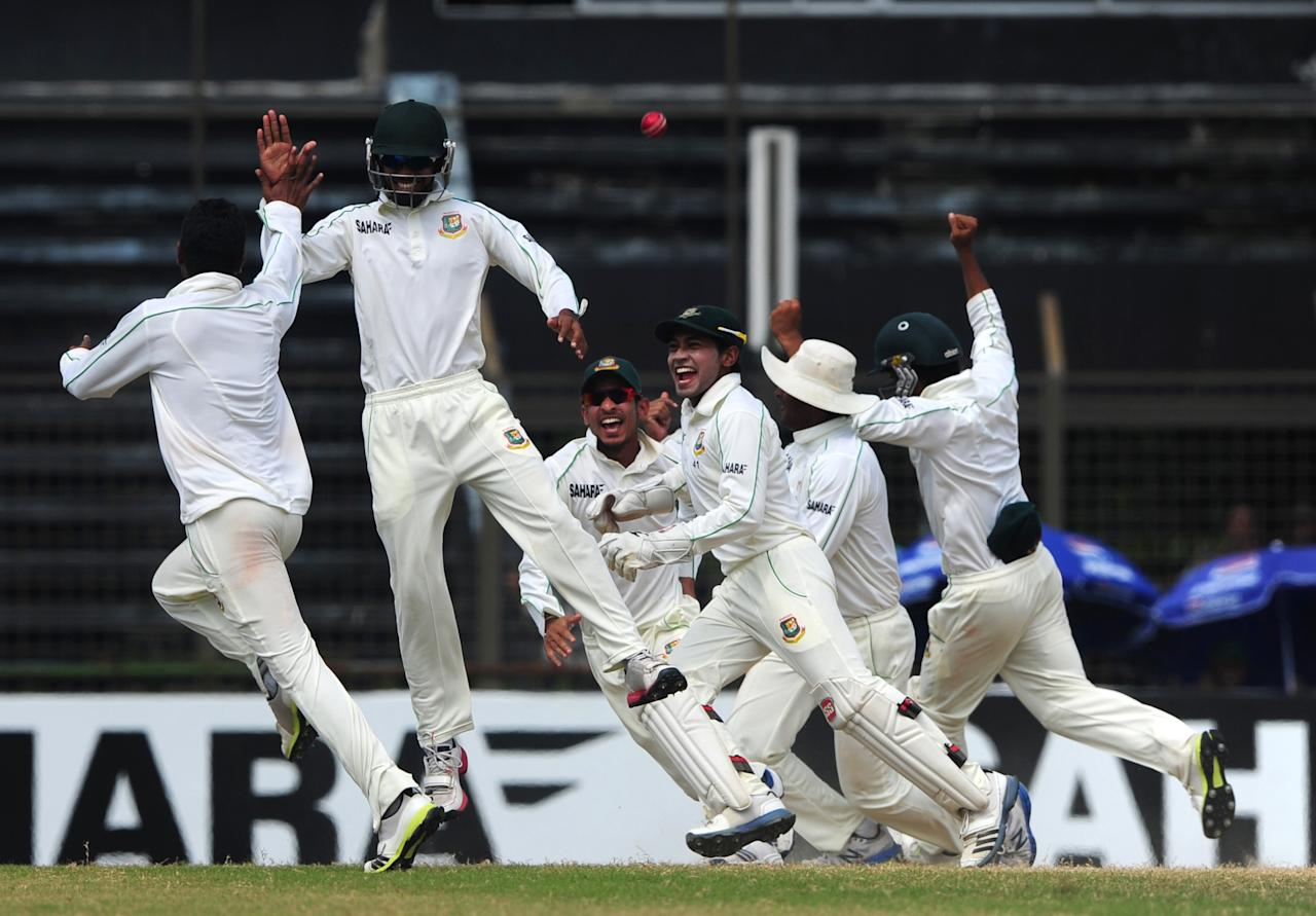 Bangladeshi bowler Sohag Gazi ( L) reacts after his hat-trick after the dismissal of the New Zealand cricketer Doug Bracewell during the fifth and final day of the first cricket Test match between Bangladesh and New Zealand at The Zahur Ahmed Chowdhury Stadium in Chittagong on October 13, 2013. AFP PHOTO/Munir uz ZAMAN        (Photo credit should read MUNIR UZ ZAMAN/AFP/Getty Images)
