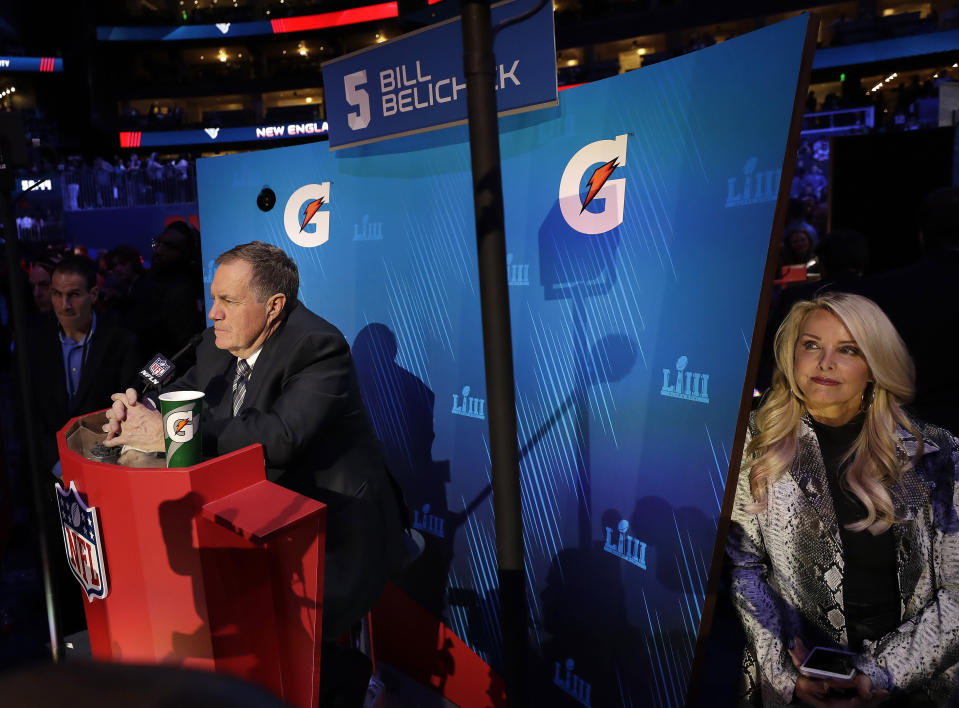 Patriots head coach Bill Belichick speaks during opening night on Monday as his girlfriend Linda Holliday looks on. (AP)