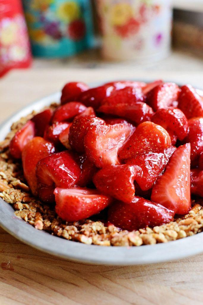 """<p>Put a twist on the usual graham cracker crust with a crunchy, salty pretzel version.</p><p><strong><a href=""""https://thepioneerwoman.com/cooking/strawberry-pretzel-pie/"""" rel=""""nofollow noopener"""" target=""""_blank"""" data-ylk=""""slk:Get the recipe."""" class=""""link rapid-noclick-resp"""">Get the recipe.</a></strong></p><p><strong><a class=""""link rapid-noclick-resp"""" href=""""https://go.redirectingat.com?id=74968X1596630&url=https%3A%2F%2Fwww.walmart.com%2Fip%2FThe-Pioneer-Woman-Vintage-Floral-9-Inch-Pie-Plate%2F130212818&sref=https%3A%2F%2Fwww.thepioneerwoman.com%2Ffood-cooking%2Fmeals-menus%2Fg32109085%2Ffourth-of-july-desserts%2F"""" rel=""""nofollow noopener"""" target=""""_blank"""" data-ylk=""""slk:SHOP PIE PLATES"""">SHOP PIE PLATES</a><br></strong></p>"""